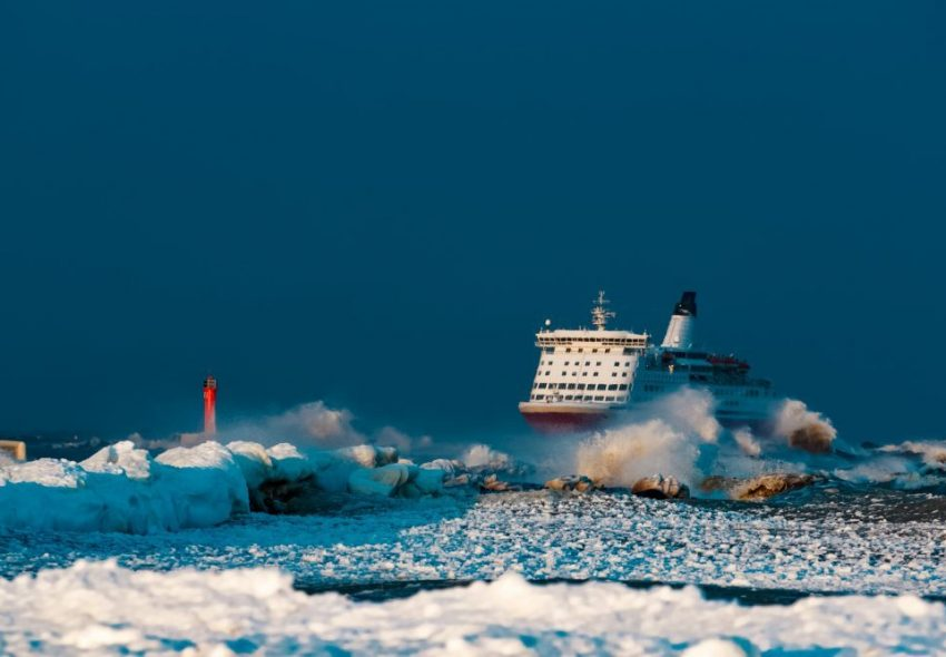 Red cruise liner. Passenger ship sailing in stormy weather